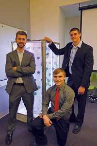 Hydro Grow LLC team members Scott Massey (left,) Jimmy Carlson and Ivan Ball pose in front of their hydroponic growing device. The team won first place at the recent Schurz Innovation Challenge at Purdue. (Purdue Research Foundation photo/Curt Slyder)
